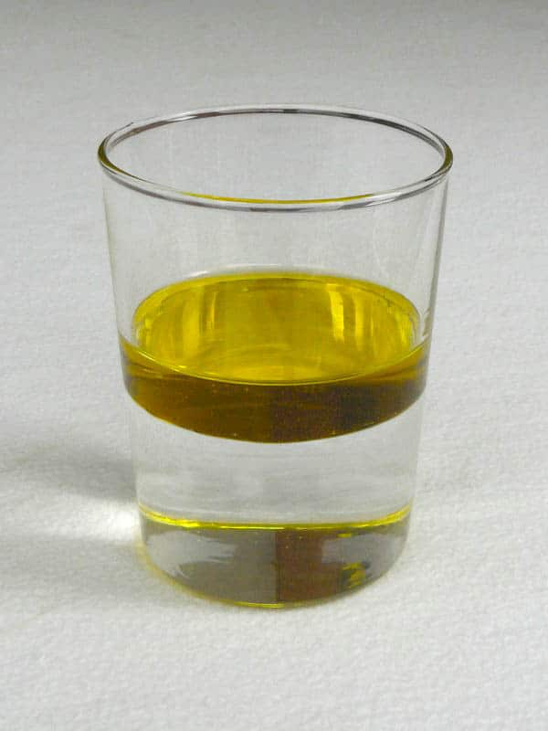 Oil floating on Water to demonstrate the miscibility